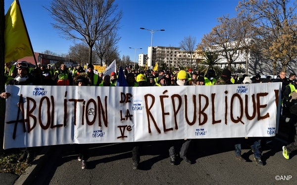 People demonstrate during a 'Yellow Vests' protest in Nimes, France, 12 January 2019. The movement in the meantime also protests the French government's tax reforms, the increasing costs of living and some even call for the resignation of French President Emmanuel Macron. The banner reads 'Abolition of the fifth republic'.