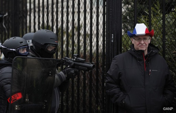 Police officers of the BAC (Anti Criminality Brigade) aim LDB-40 flashball (non-lethal rubber bullet guns) as protesters from the 'Gilets Jaunes' (Yellow Vests) movement take part in the 'Act IX' demonstration (the 9th consecutive national protest on a Saturday) near Place de l'Etoile, near the Arc de Triomphe, in Paris, France, 12 January 2019.