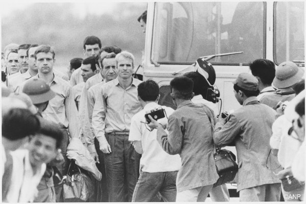 An undated photograph made available by the National Archives on 25 August 2018 shows Naval Aviator John McCain (C) as he is being released with other prisoners of war from detention in North Vietnam in 1973