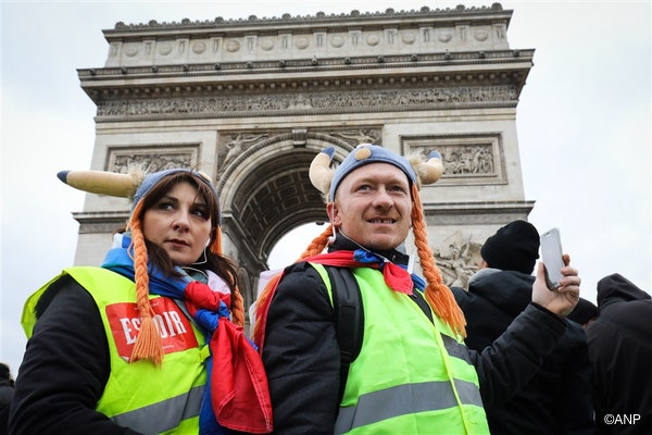 Protesters dressed as Gauls and wearing a yellow vest (gilet jaune) take part in an anti-government demonstration called by the Yellow Vest movement next to the Arc de Triomphe in Paris, on January 12, 2019.