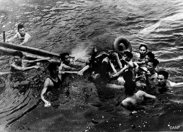 A photo taken 26 October 1967 shows US Navy Airforce Major John McCain (C) being rescued from Hanoi©s Truc Bach lake by several Hanoi residents after his Navy warplane was downed by Northern Vietnamese army during the Vietnam War. One of his rescuers said 24 February 2000, McCain was well treated after being pulled from the lake by villagers. McCain said that upon capture he was beaten by an angry mob and bayoneted in the groin..